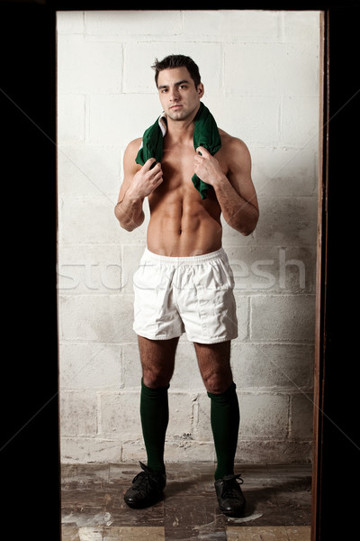 Male rugby player in front of concrete block wall. Stock photo © nickp37