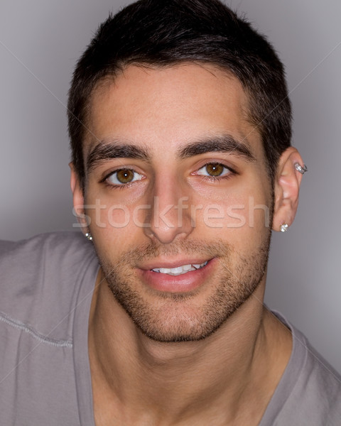 Headshot of a young man. Studio shot over grey. Stock photo © nickp37