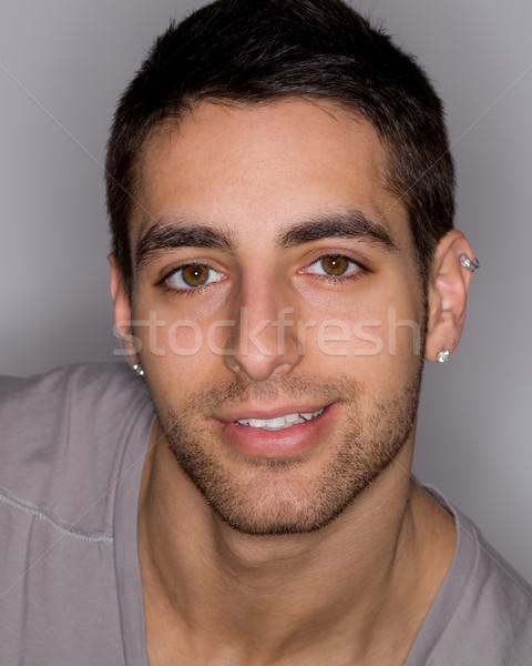 Сток-фото: молодым · человеком · серый · лице · человек · улыбаясь