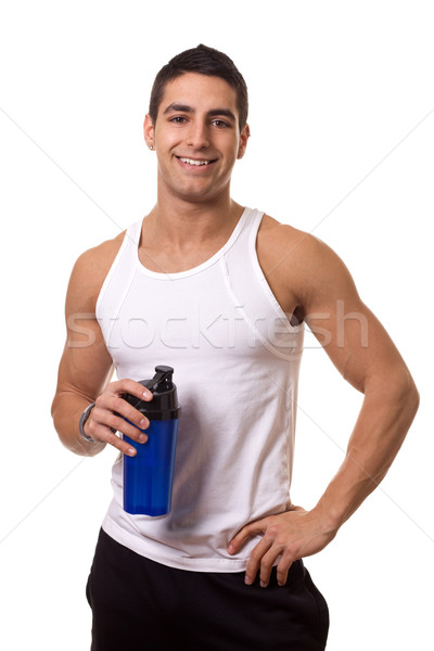 Athletic man with water bottle. Studio shot over white. Stock photo © nickp37