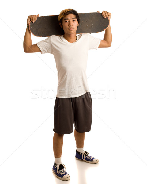 Сток-фото: молодым · человеком · скейтборде · белый · скейтбордист · человека