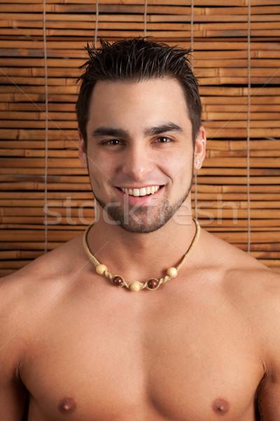 çekici adam gömleksiz bambu ekran yaz Stok fotoğraf © nickp37