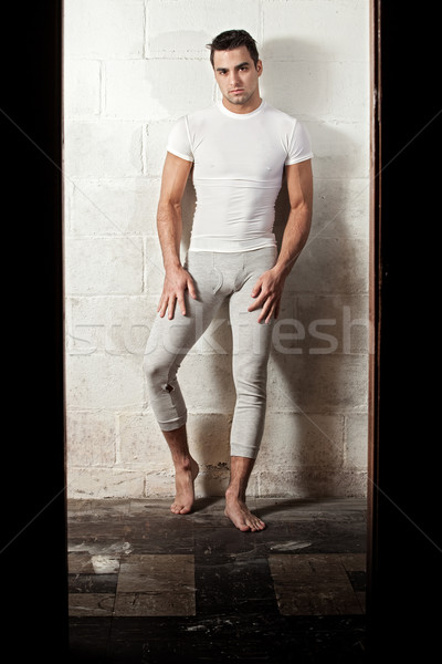 Man in long underwear and white compresion shirt. Stock photo © nickp37