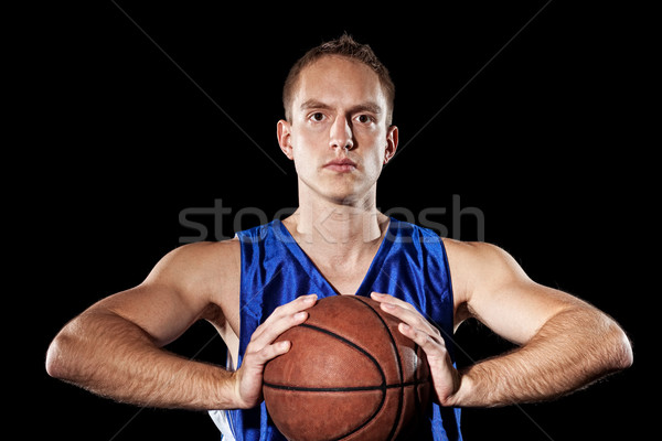 Male basketball player. Studio shot over black. Stock photo © nickp37