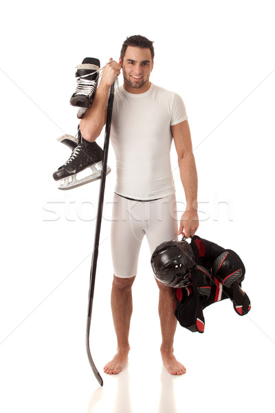 Athletic young man with ice hockey equipment. Stock photo © nickp37