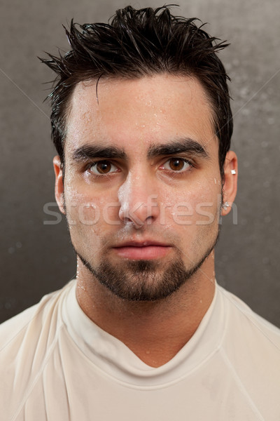 Headshot on a young man. Wet look with grey background. Stock photo © nickp37