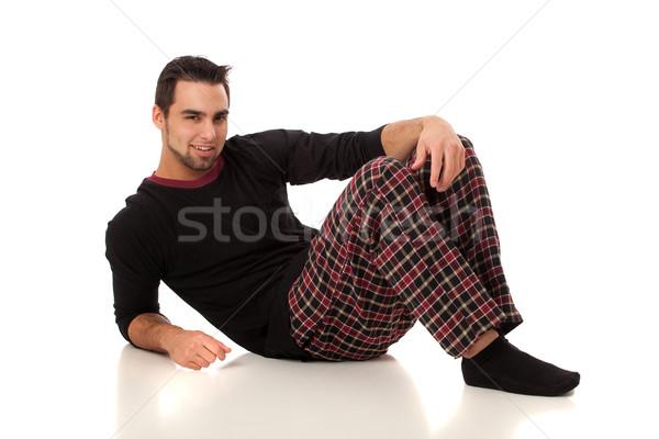 Attractive man in pajamas. Studio shot over white. Stock photo © nickp37