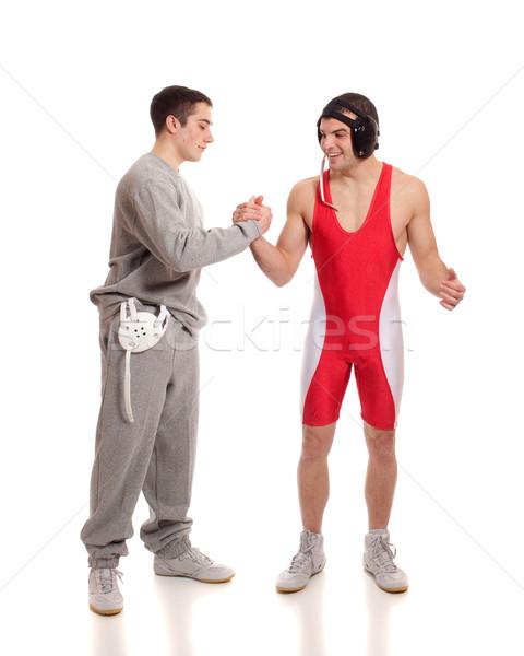 Wrestler and teammate. Studio shot over white. Stock photo © nickp37