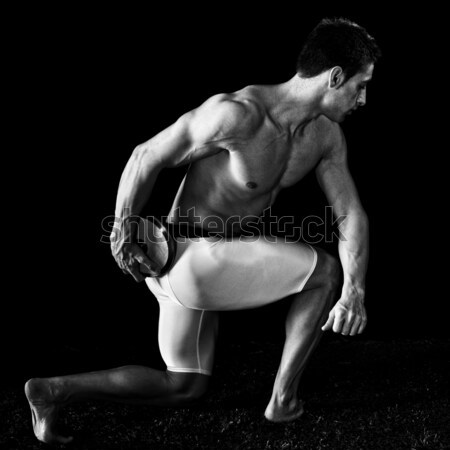 Athlete with discus. Studio shot over black. Stock photo © nickp37