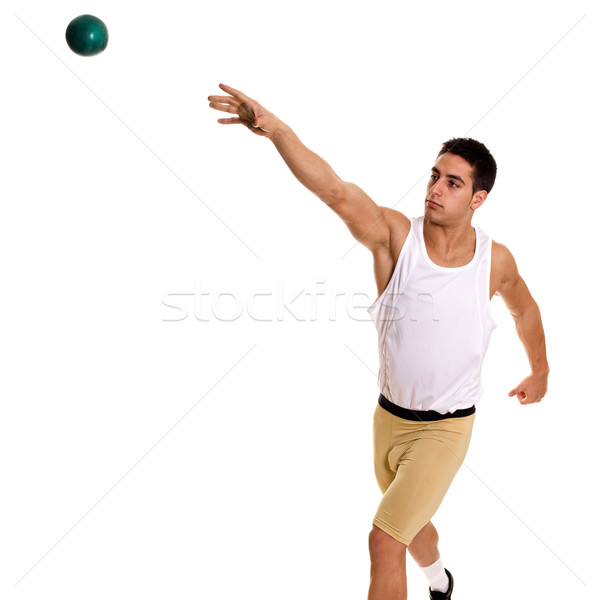 Stock photo: Track and field athlete competing shot put. Studio shot over white.