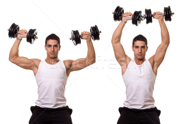 Seated shoulder press. Studio shot over white. Stock photo © nickp37