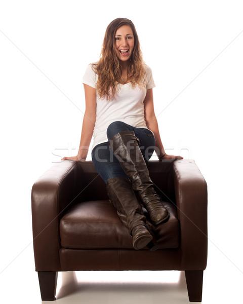 Casual mulher mulher jovem couro cadeira Foto stock © nickp37