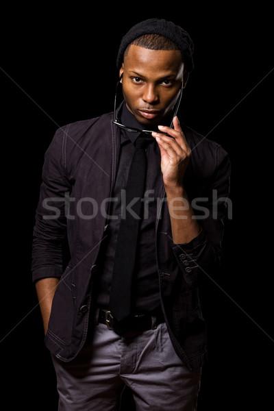 Divatos fiatalember stúdiófelvétel fekete férfi szemüveg Stock fotó © nickp37