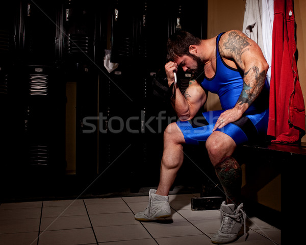 Muscular wrestler in a locker room before or after a match. Stock photo © nickp37