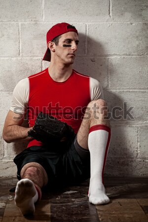 Baseball player in front of concrete block wall. Stock photo © nickp37
