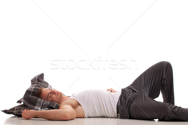 Man in pajamas. Studio shot over white. Stock photo © nickp37