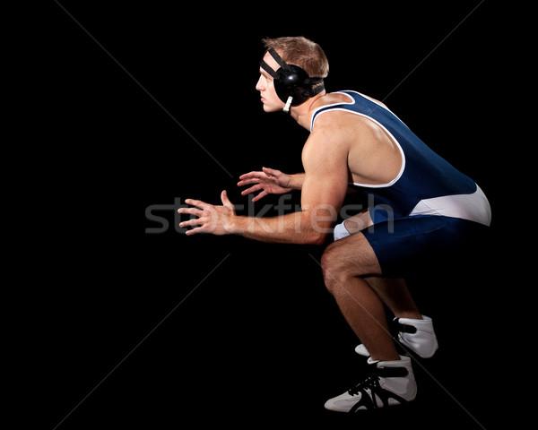 Wrestler in a blue singlet. Studio shot over black. Stock photo © nickp37