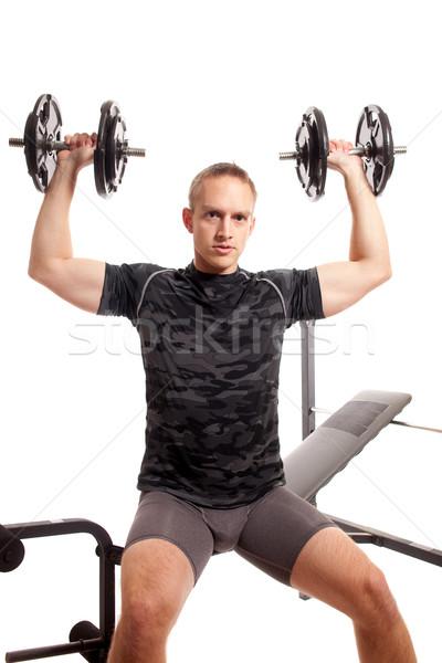 Fiatalember emel súlyok stúdiófelvétel fehér fitnessz Stock fotó © nickp37