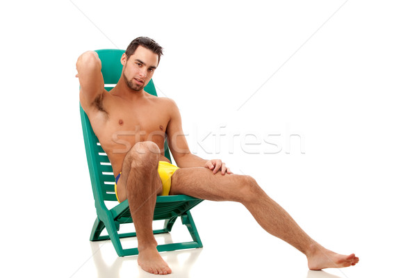 Attractive young man in swimsuit. Studio shot over white. Stock photo © nickp37
