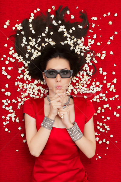 Surprised Girl with 3D Cinema Glasses and Popcorn Watching a Movie Stock photo © NicoletaIonescu