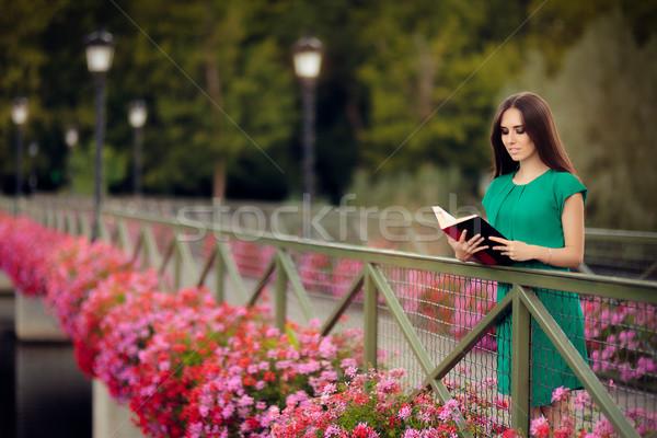 Nő olvas könyv híd virágok portré Stock fotó © NicoletaIonescu
