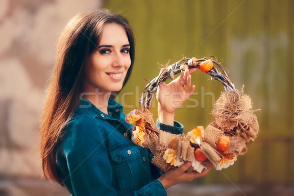 Happy Girl Holding Decorative Autumn Wreath Stock photo © NicoletaIonescu