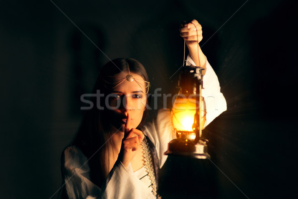 Medieval Princess Holding Lantern and Keeping a Secret Stock photo © NicoletaIonescu