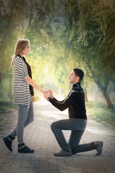 Kneeling Man Proposing with an Engagement Ring Stock photo © NicoletaIonescu