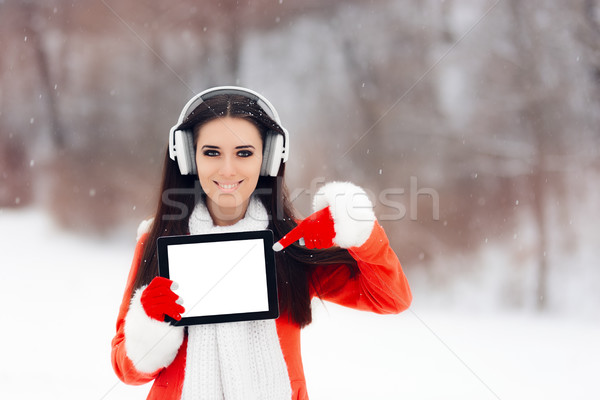 Smiling  Girl with Headphones Holding Tablet Pc  Stock photo © NicoletaIonescu