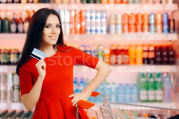 Happy Customer Holding Credit Card in a Supermarket Stock photo © NicoletaIonescu