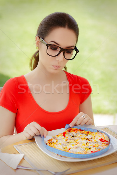 Surprised Woman Measures Pizza with Measure Tape  Stock photo © NicoletaIonescu