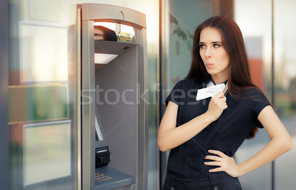 Surprised Businesswoman with Credit Card at ATM cash machine Stock photo © NicoletaIonescu
