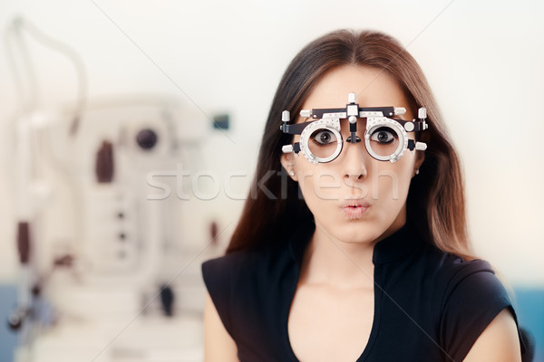 Funny Girl at Ophthalmological Exam Wearing Eye Test Glasses  Stock photo © NicoletaIonescu