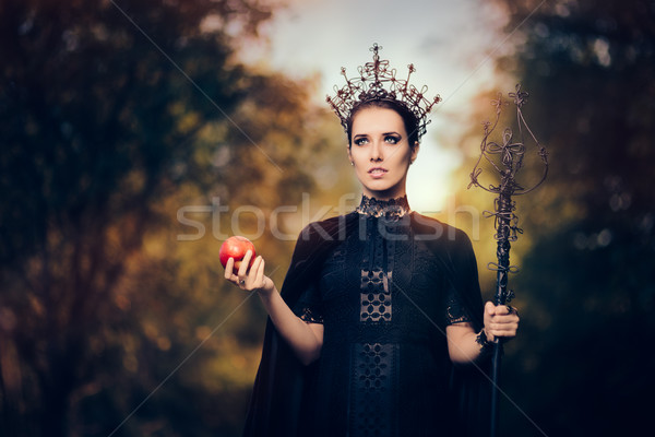 Evil Queen with Poisoned  Apple in Fantasy Portrait Stock photo © NicoletaIonescu