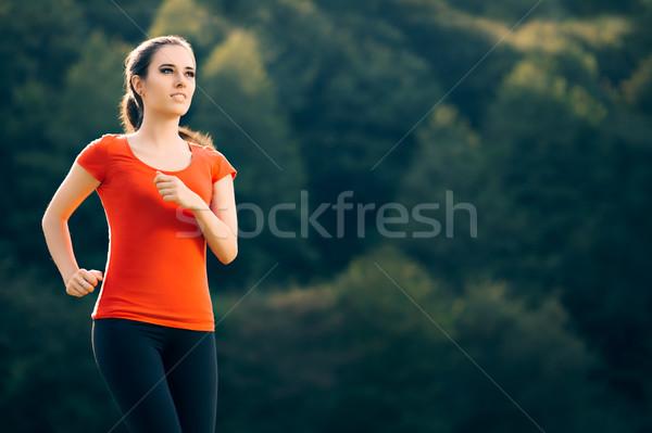 Boldog fitt nő fut kívül fitnessz Stock fotó © NicoletaIonescu