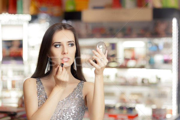 Glamour Woman with Lipstick and Make-up Mirror  Stock photo © NicoletaIonescu