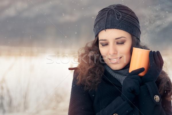 Winter Woman Holding a Hot Drink Mug Stock photo © NicoletaIonescu