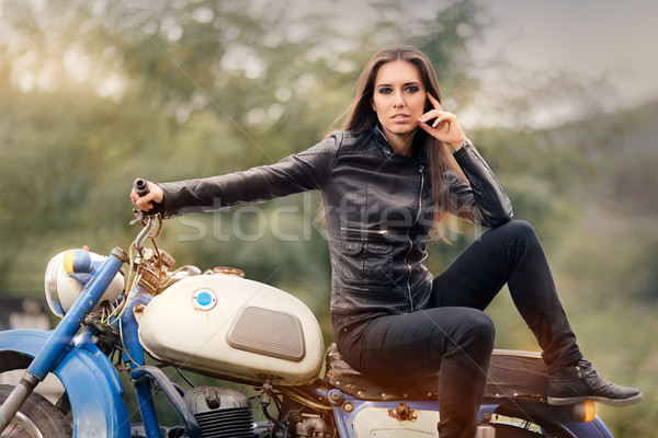 Biker Girl in Leather Jacket on Retro Motorcycle Stock photo © NicoletaIonescu