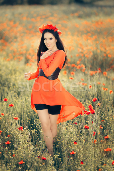 Beautiful Woman with Floral Wreath in a Field of Poppies  Stock photo © NicoletaIonescu