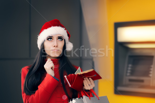 Funny Christmas Woman Holding a Coin  Stock photo © NicoletaIonescu