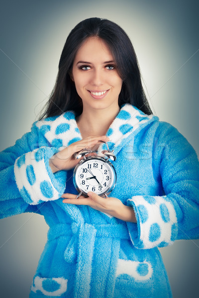 Young Woman in Bathrobe Holding an Alarm Clock  Stock photo © NicoletaIonescu