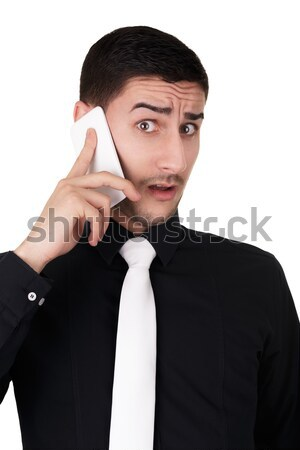 Young Businessman with Surprised Expression on the Phone  Stock photo © NicoletaIonescu