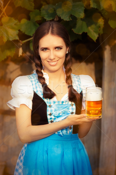 Young Bavarian Woman Holding Beer Tankard  Stock photo © NicoletaIonescu