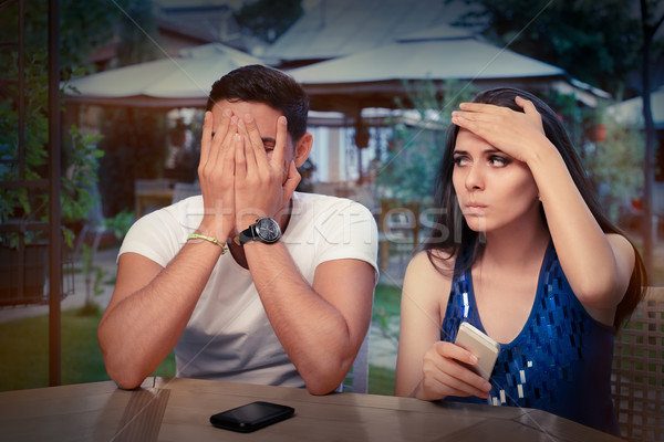 Young Couple Having Problems with Their Smart Phones  Stock photo © NicoletaIonescu