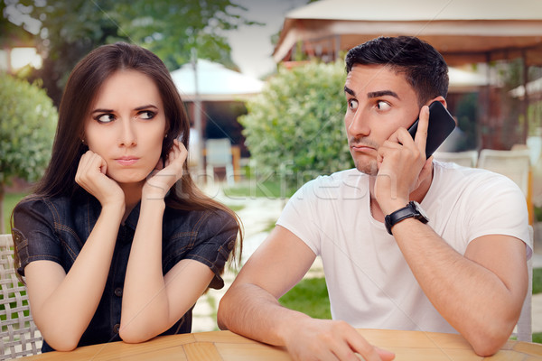 Angry Girl Listening to Her Boyfriend Talking on The Phone Stock photo © NicoletaIonescu