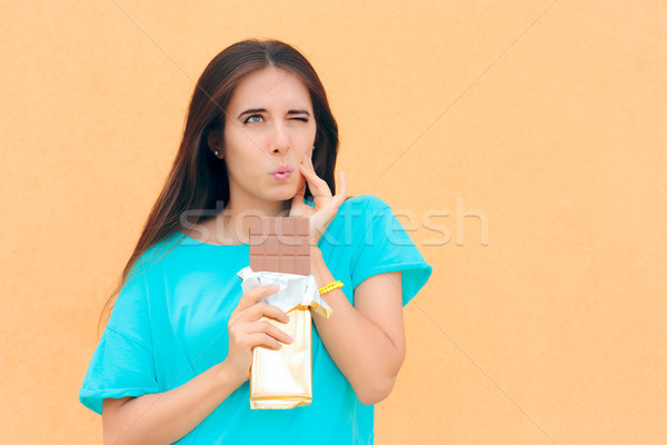 Woman Suffering Toothache After Eating Chocolate Stock photo © NicoletaIonescu
