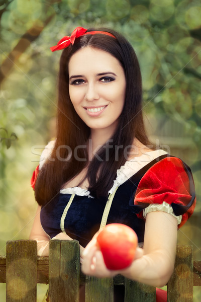 Snow White Holding a Red Apple Fairy Tale Portrait  Stock photo © NicoletaIonescu