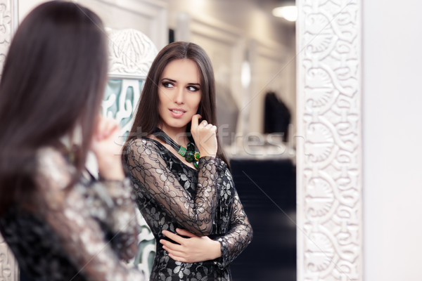Beautiful Girl in Black Lace Dress Looking in the Mirror Stock photo © NicoletaIonescu