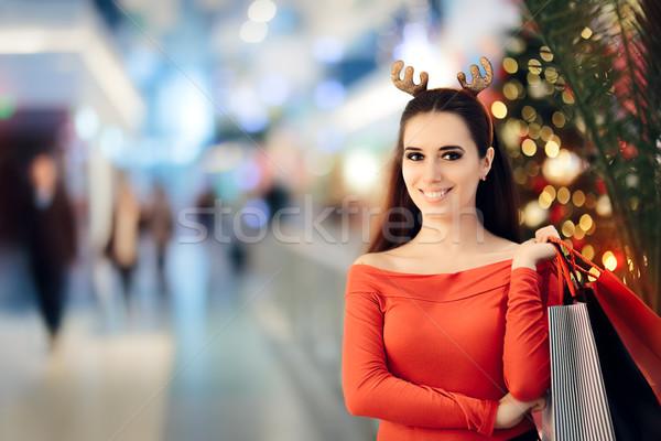 Compras mulher natal rena Foto stock © NicoletaIonescu