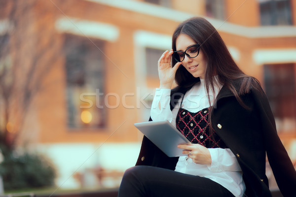 Business Woman with Reading Glasses and Tablet PC Outside  Stock photo © NicoletaIonescu